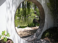 Peaceful setting with pond through round opening